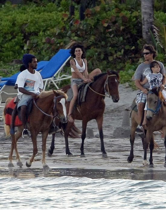 fp_2070335_amy_winehouse_rides_horses_in_st__lucia_at_sunset_1